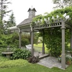 Our stunning outdoor setting is surrounded by lavish perennial gardens, gorgeous stone statuary and a shady pergola.