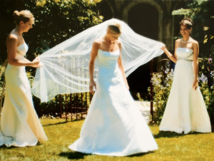 The beautiful bride and attendants pose in the garden.